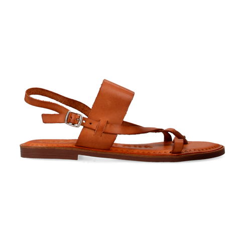 A strappy sandal featuring a leather footbed, leather straps, and a minimal side buckle. Comes in tan and black-nappa.