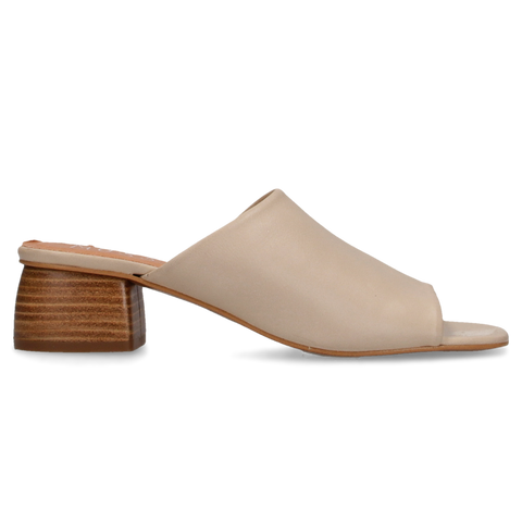 An open-toe mule that features a wood heel, leather footbed and leather upper. Comes in ice and black-nappa.