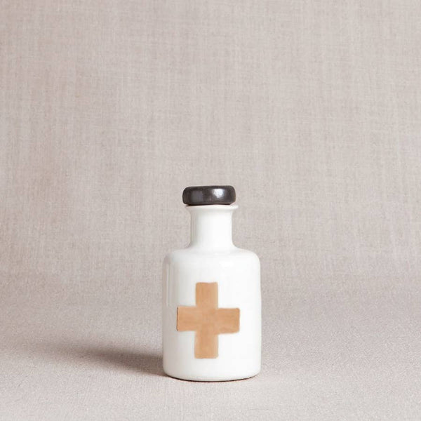 apothecary bottle in gold cross