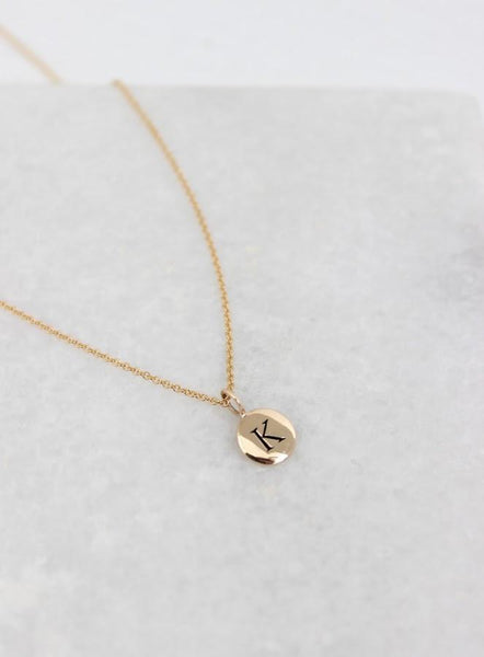 necklace with gold initial medallion