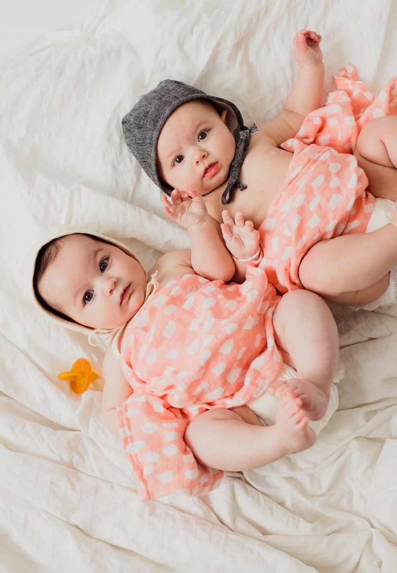 swaddle in spotted blush - Piper & Chloe