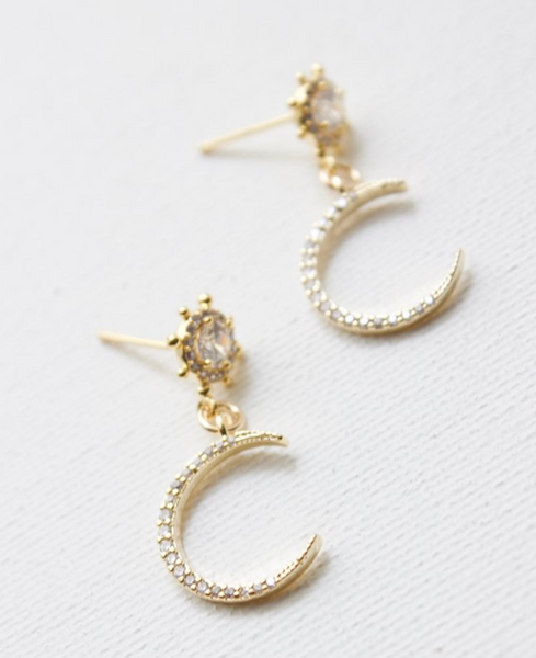 earrings in crescent moons and round cz studs