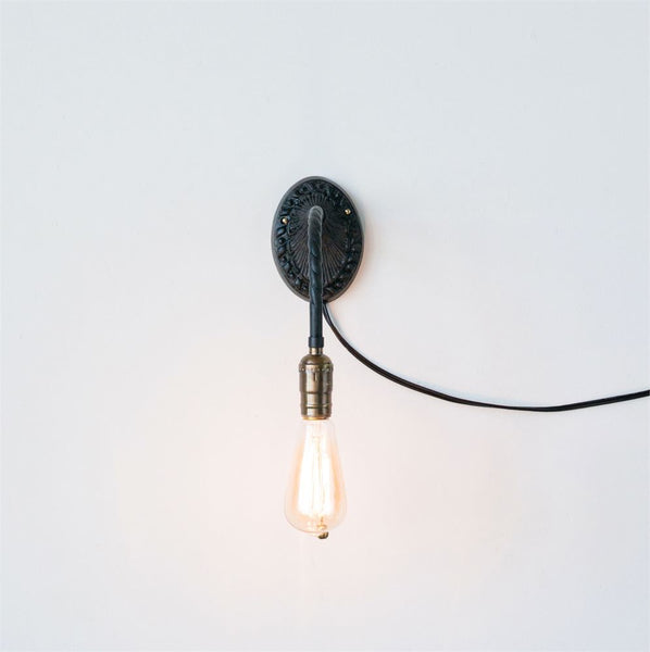 black metal wall sconce with pull chain