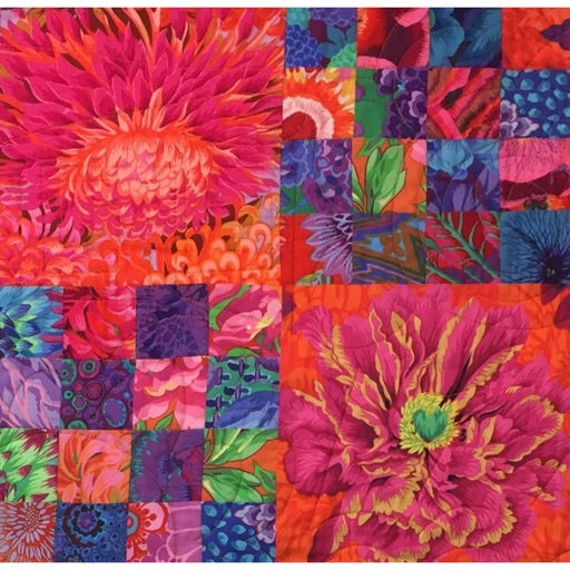 "Bold Blossoms - a great quilt to show off prints with large flowers. 72"" square."