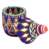 Top view of a large and colourful vintage berber bread basket with its lid off