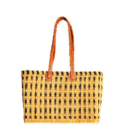 Front view of a medium sized, rectangular, flat based Moroccan shopping basket handmade with woven palm fibres and long plaited leather handles