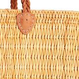 Close-up view of a medium sized, rectangular, flat based Moroccan shopping basket handmade with woven palm fibres and long plaited leather handles