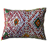 front view of a multicoloured, handmade, geometrically patterned vintage Moroccan wool cushion embellished with sequins