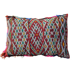 front view of a pillow shaped vintage Moroccan cushion made of wool with a geometric pattern