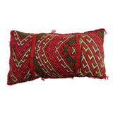 front view of a multicoloured, handmade, geometrically patterned vintage Moroccan wool cushion
