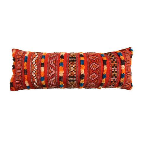 front view of an extra long multicoloured, handmade, geometrically patterned vintage Moroccan wool cushion