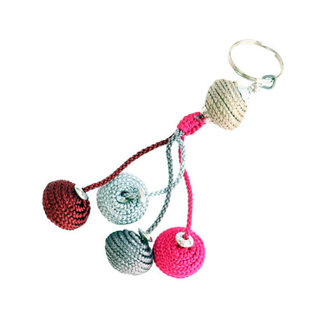 top view of a multicoloured Moroccan keyring with five bobbles covered with corded embroidery silk