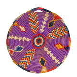front view of multicoloured, handmade, geometrically patterned vintage Moroccan wool table mat