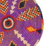 close-up view of multicoloured, handmade, geometrically patterned vintage Moroccan wool table mat