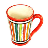 Top view of a medium sized ceramic Moroccan mug, multi-coloured stripes with red rim and handle