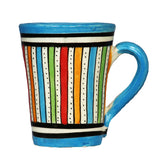 Front view of a medium sized ceramic Moroccan mug, multi-coloured stripes with turquoise rim and handle