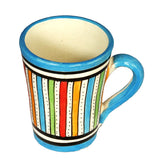 Top view of a medium sized ceramic Moroccan mug, multi-coloured stripes with turquoise rim and handle