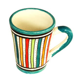 Top view of a medium sized ceramic Moroccan mug, multi-coloured stripes with teal green rim and handle