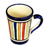 top view of a medium sized ceramic Moroccan mug, multi-coloured stripes with dark blue rim and handle
