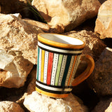 View of a small ceramic Moroccan mug ideal for espresso, multi-coloured stripes with orange rim