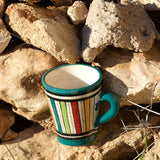 View of a small ceramic Moroccan mug ideal for espresso, multi-coloured stripes with teal green rim