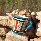 View of a small ceramic Moroccan mug ideal for espresso, multi-coloured stripes with turquoise rim