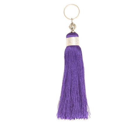 front view of a deep purple Moroccan tassel handmade with embroidery silks and a metal bead