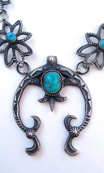 KEVIN BILLAH Sandcast Sterling Silver and Kingman Turquoise Naja Squash Blossom