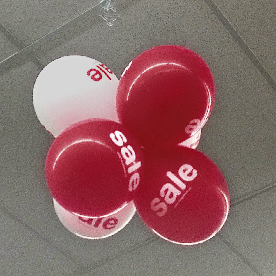 Twist Clip & Hook suspending a cluster of sale balloons