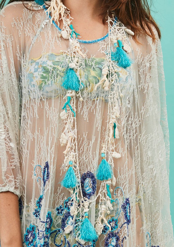beach necklace by antica sartoria with tassels and shells