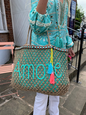 Macrame bag with embroidery & tassel trim