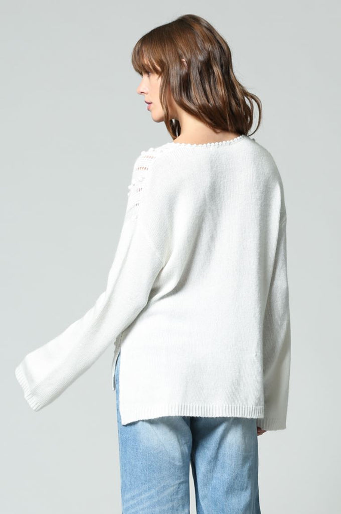 CREAM  V-NECK PULL OVER SWEATER WITH BABY POM POM DETAIL