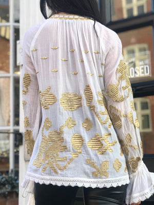 White top with statement gold embroidery