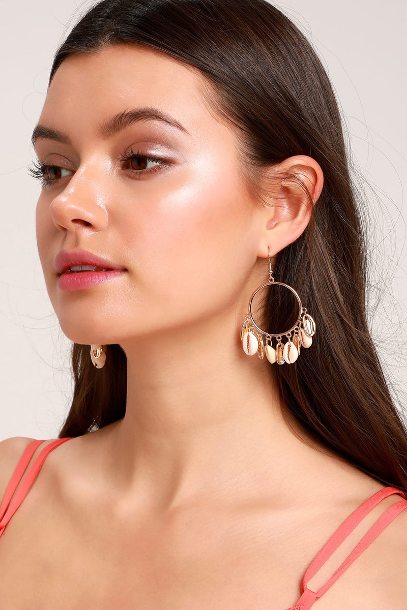 Gold hoop earrings with shell design