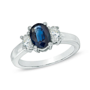 Oval Blue Sapphire and 3/8 CT. T.W. Diamond Three Stone Ring in 14K White Gold