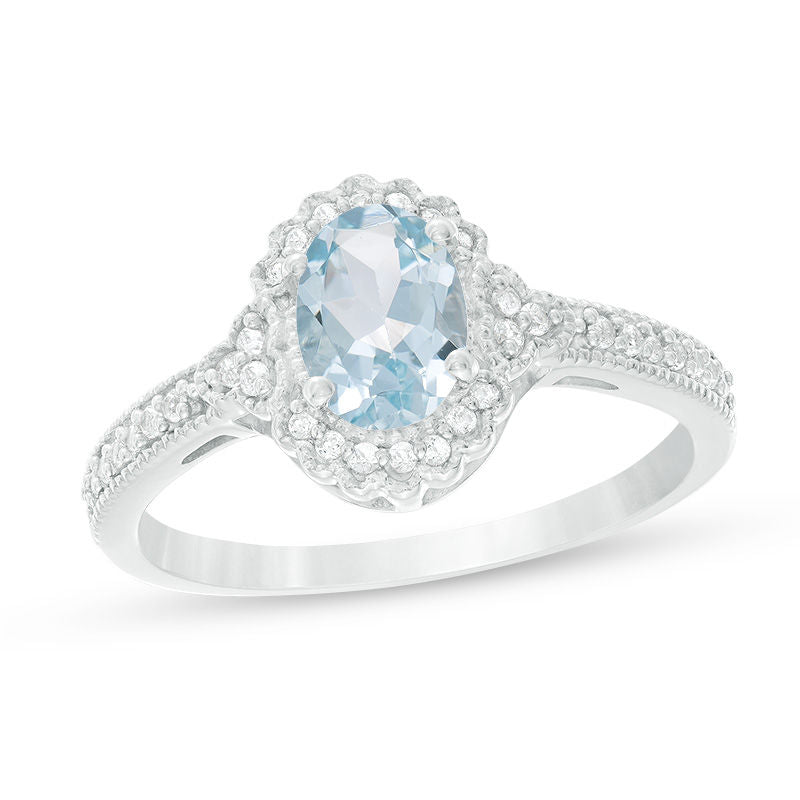 Oval Aquamarine and 1 8 CT Diamond Frame Vintage-Style Ring in 14K White gold