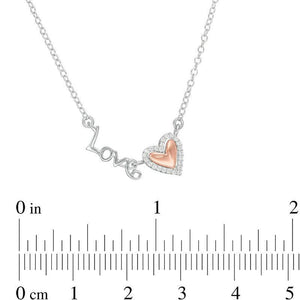 "1/15 CT. T.W. Diamond ""Love"" Heart Necklace in 10K Two-Tone Gold"
