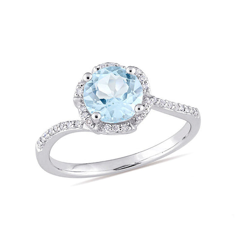 7.0mm Blue Topaz and 1/10 CT. T.W. Diamond Floral Frame Bypass Ring in 14K White Gold