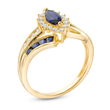 Load image into Gallery viewer, Marquise Blue Sapphire and 1/6 CT. T.W. Diamond Double Row Bypass Ring in 10K Gold