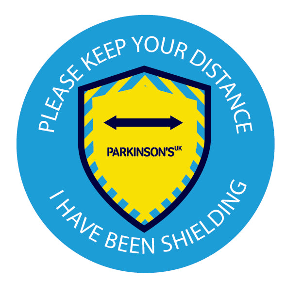 Parkinson's UK keep your distance shielding pin badge
