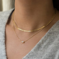 Model wearing Gold Chain Choker and Baguette Layered Necklace with sweater