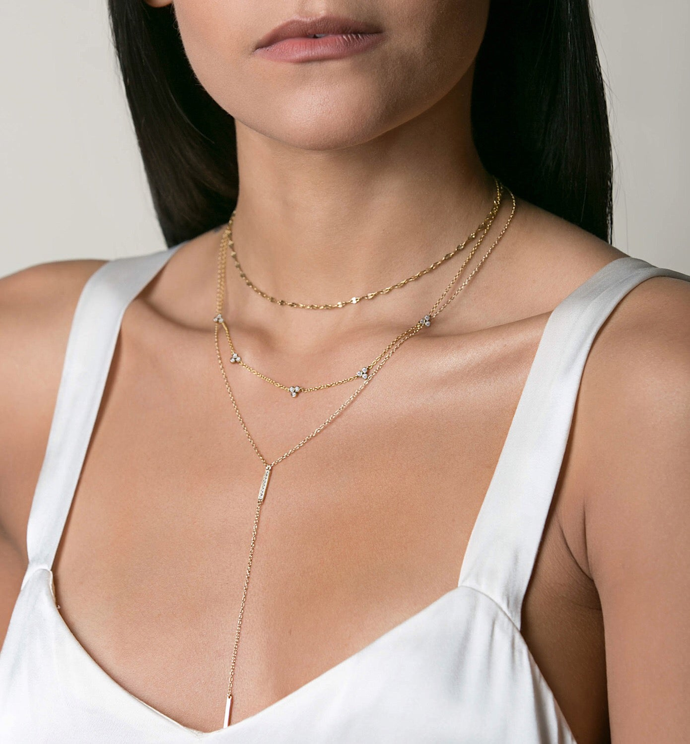 Model wearing Gold Clover Layered Necklace Set