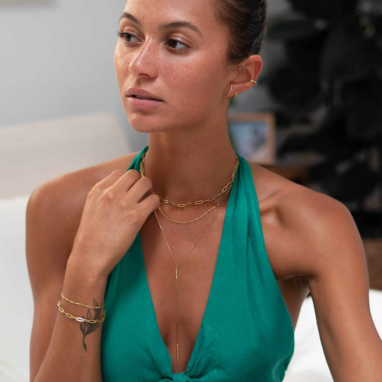 Model wearing Gold Link Chain, Marina and Bar Lariat Layered Necklace