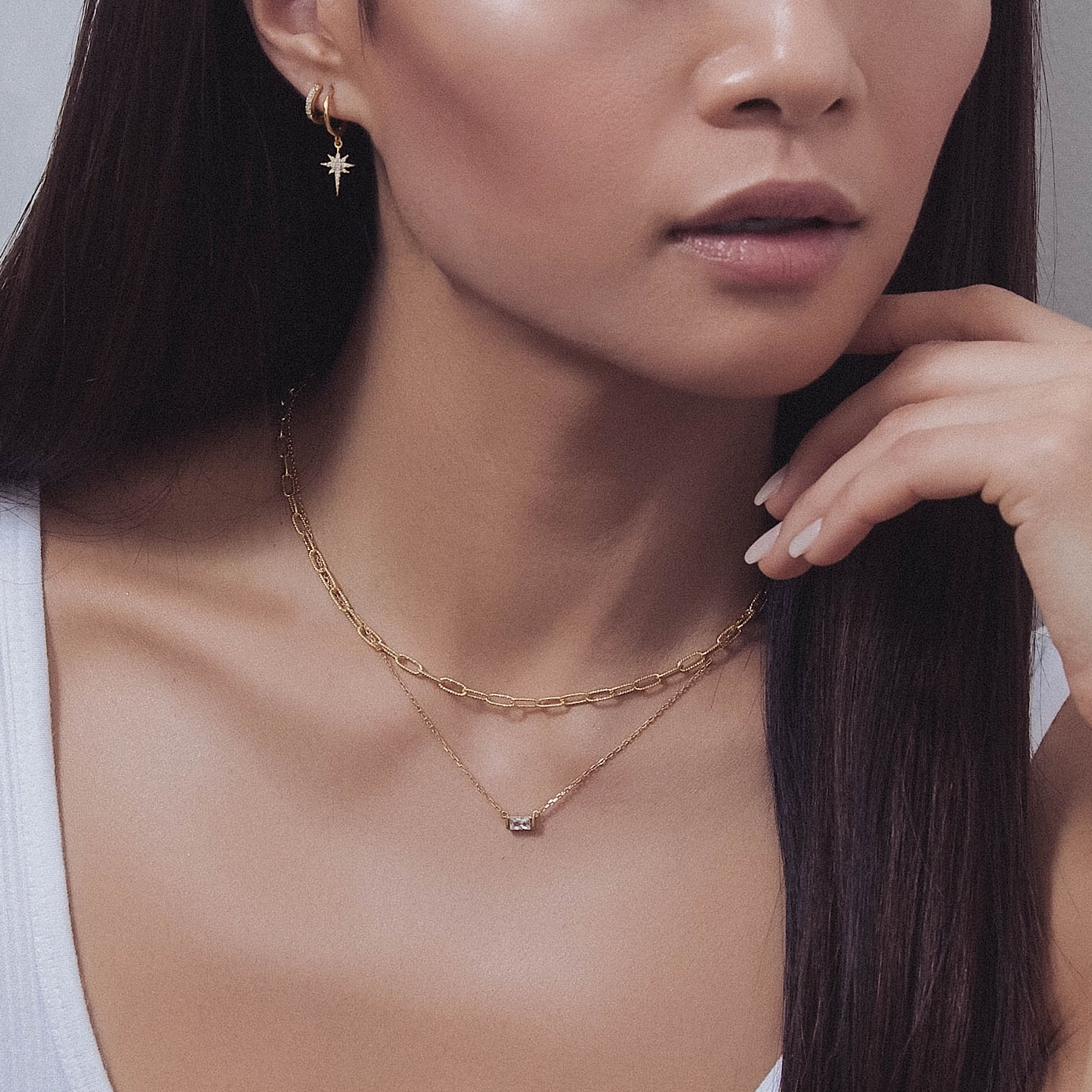 Model wearing Gold Chain Link and Baguette Layered Necklace