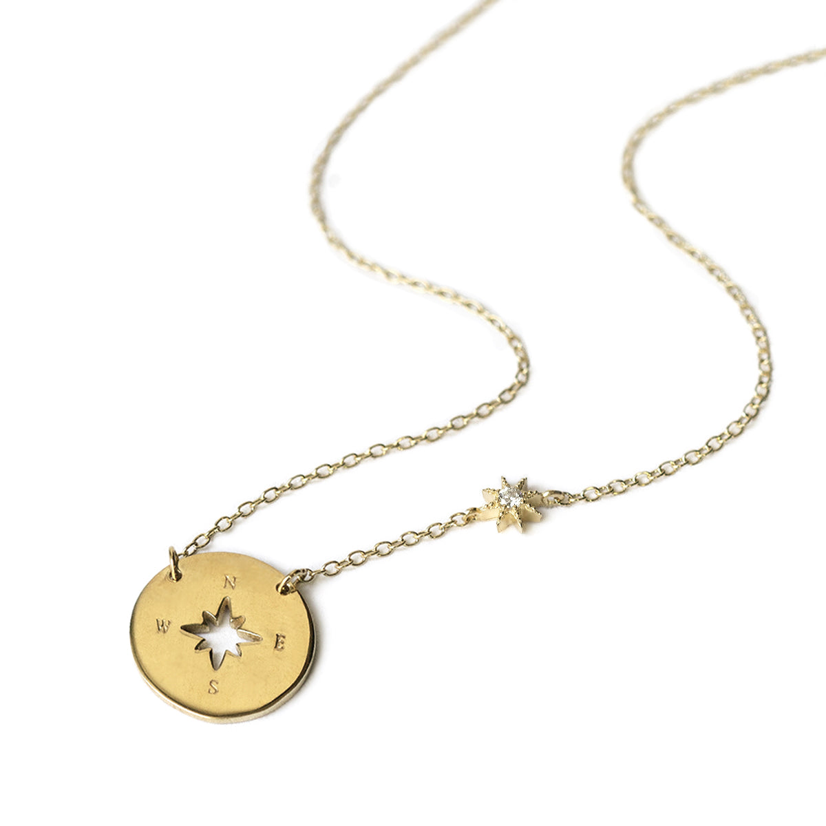 Gold Compass Necklace with a tiny Star