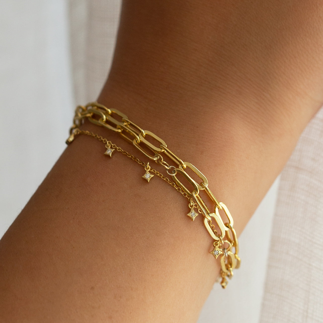 Gold Bracelet Stack paired with Gold Dangle Bracelet