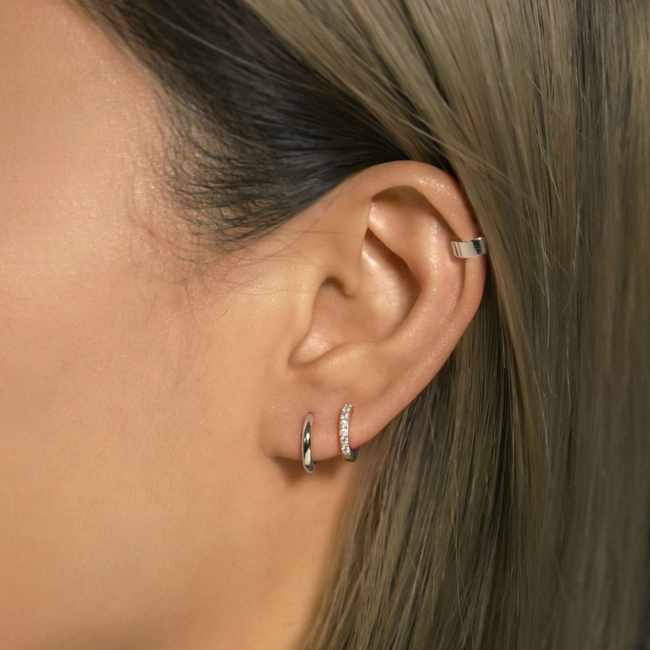 Silver Ear Cuff worn on cartilage with tiny huggie hoop earrings