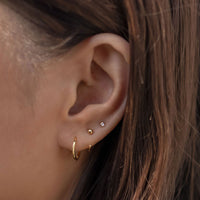Gold Huggie Hoop Earrings with Tiny Crystal Stud in an Ear Stack