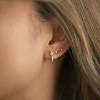Gold clover pave huggie hoop earring with tiny triangle and star stud earring
