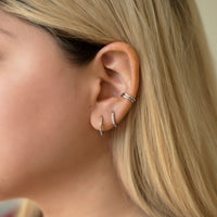 Sterling Silver Curated Ear with Cross Bead Hoops, Pave Huggie Earrings and Eternity Ear Cuffs